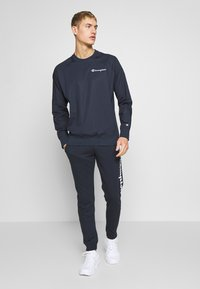 Champion - CUFF PANTS - Verryttelyhousut - dark blue - 1