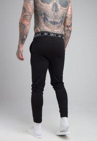 SIKSILK - LOUNGE PANTS - Spodnie od piżamy - black - 2