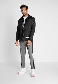 Puma - REACTIVE PACKABLE PANT - Outdoor trousers - castlerock black/white - 1