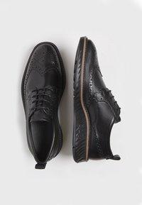 ECCO - ST.1 HYBRID  - Zapatos con cordones - black - 1