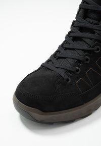 Lowa - SASSELLO II GTX MID - Winter boots - schwarz - 5