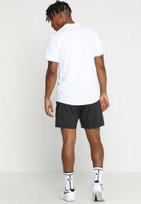 Nike Performance - DRY BLADE - Print T-shirt - white/black - 2
