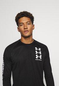 Under Armour - T-shirt de sport - black - 3