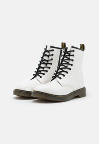 Dr. Martens - 1460 - Lace-up ankle boots - white - 1