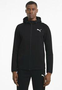 Puma - Zip-up hoodie - black - 0