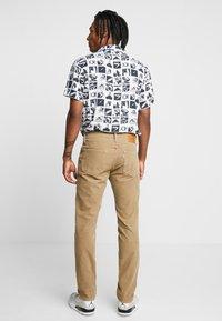 Levi's® - 511™ SLIM FIT - Trousers - beige - 2