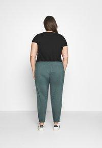 Nike Sportswear - PANT TREND PLUS - Tracksuit bottoms - hasta/white - 2