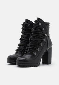 DKNY - LENNI LACE UP - Kotníková obuv na vysokém podpatku - black - 2