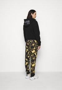Versace Jeans Couture - Spodnie treningowe - black - 2