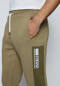 BOSS - HADIKO  - Tracksuit bottoms - dark green - 3