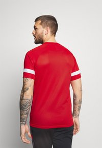 Nike Performance - Triko spotiskem - university red/white - 2