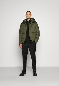 Calvin Klein Jeans - HOODED PUFFER JACKET - Winter jacket - deep depths - 1
