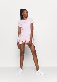 Nike Performance - INFINITE - Print T-shirt - pink foam/reflective silver - 1