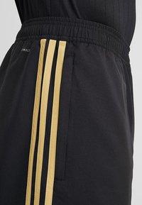 adidas Performance - REAL MADRID - Sports shorts - black/dark gold - 4