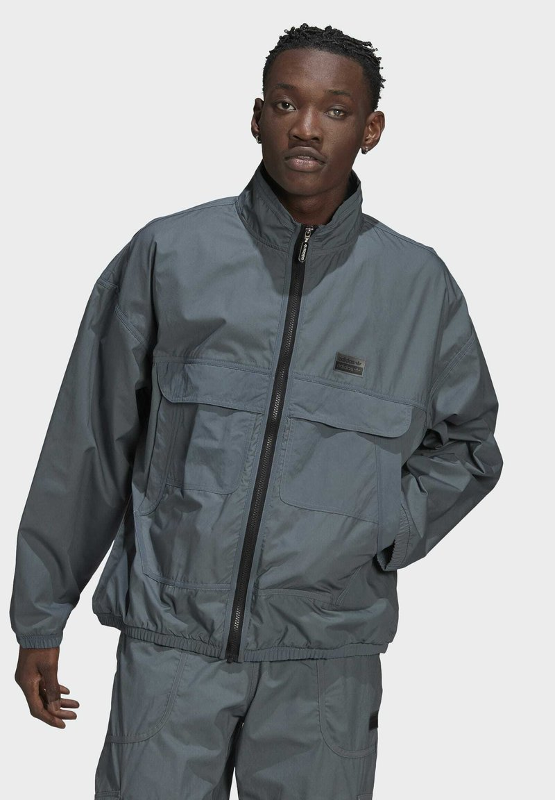 adidas Originals - FASHION TT - Training jacket - blue