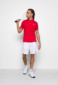 Nike Performance - Sports shorts - white/black - 1