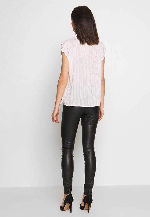 KAYLEE - Leggings - Trousers - black