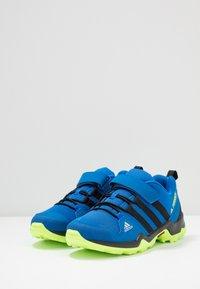 adidas Performance - TERREX AX2R UNISEX - Hiking shoes - glow blue/core black/signal green - 3