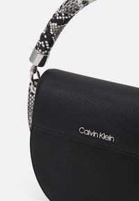Calvin Klein - SADDLE BAG - Handbag - black - 3