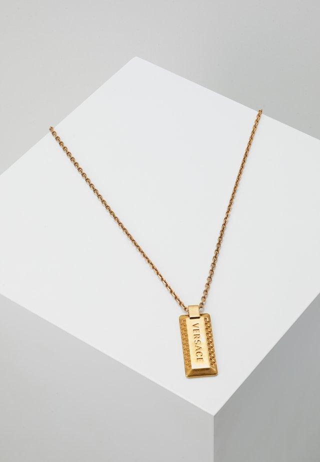 Collier - oro tribute