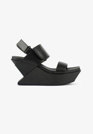 DELTA - Wedge sandals - black