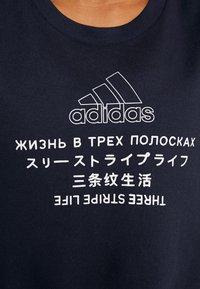 adidas Performance - GLOBAL CREW - Mikina - dark blue - 7