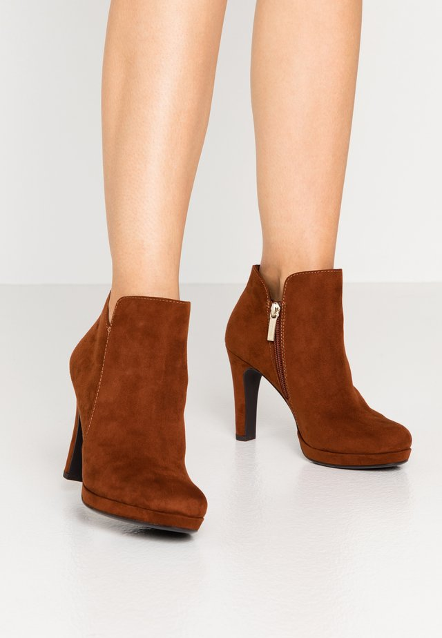 High heeled ankle boots - brandy