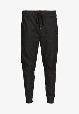 FINN - Trousers - black