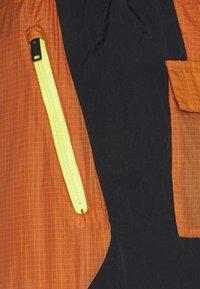 Jordan - TRACK PANT - Träningsbyxor - monarch/black/opti yellow - 7