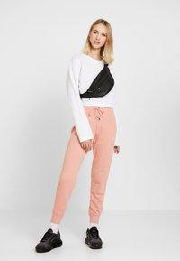 Nike Sportswear - PANT TIGHT - Tracksuit bottoms - pink quartz/white - 1