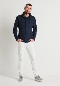 J.LINDEBERG - JAY SOLID - Jeans slim fit - cloud white - 1
