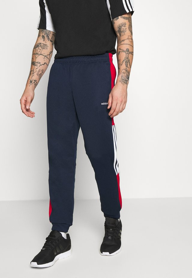 CLASSICS  - Tracksuit bottoms - conavy/scarle