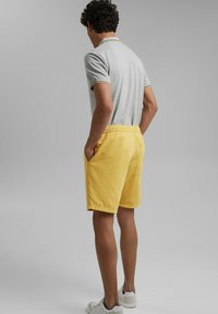 edc by Esprit - Tracksuit bottoms - light yellow - 2
