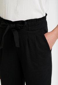 Vero Moda - VMDATCA BUCKET PANTS - Tracksuit bottoms - black - 4