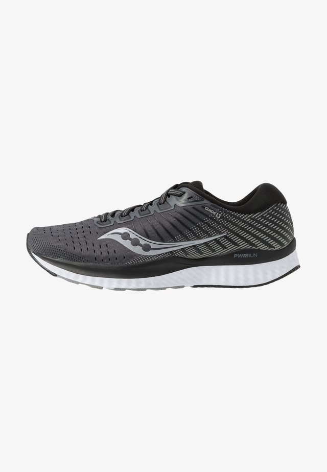GUIDE - Neutral running shoes - black/white