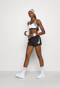 Nike Performance - RUN SHORT - Sports shorts - black/silver - 1
