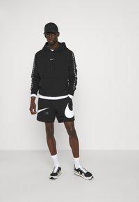 Nike Sportswear - REPEAT HOODIE - Sweatshirt - black/white - 1