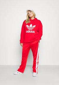 adidas Originals - ADIBREAK - Trainingsbroek - red - 1