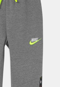 Nike Sportswear - Tracksuit bottoms - carbon heather - 2