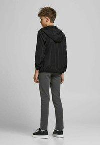 Jack & Jones Junior - Light jacket - black - 2