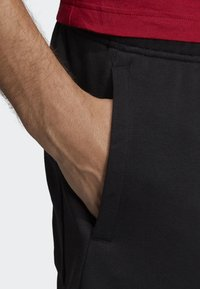 adidas Performance - MUST HAVES BADGE OF SPORT SHORTS - Sports shorts - black - 4