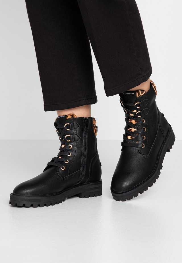 DELANA - Lace-up ankle boots - black