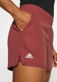 adidas Performance - CLUB SHORT - Sports shorts - red - 4