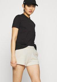 Calvin Klein Jeans - LOGO TRIM - Tracksuit bottoms - white sand - 3