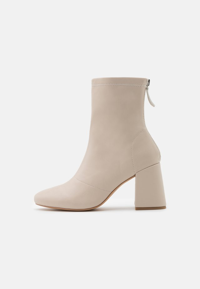BLOCK HEEL SOCK BOOTS - Classic ankle boots - cream