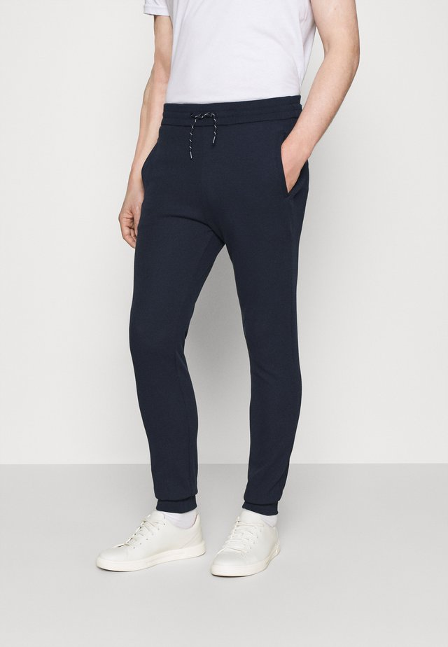 SOJOGGY - Pantalon de survêtement - navy
