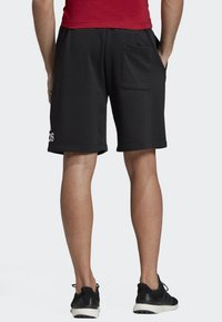 adidas Performance - MUST HAVES BADGE OF SPORT SHORTS - Sports shorts - black - 1