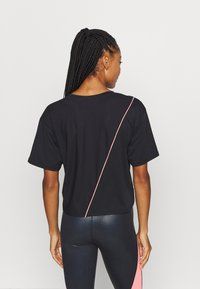 Puma - TRAIN PEARL TEE - Funktionsshirt - black - 2