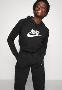 Nike Sportswear - Spodnie treningowe - black/white - 6
