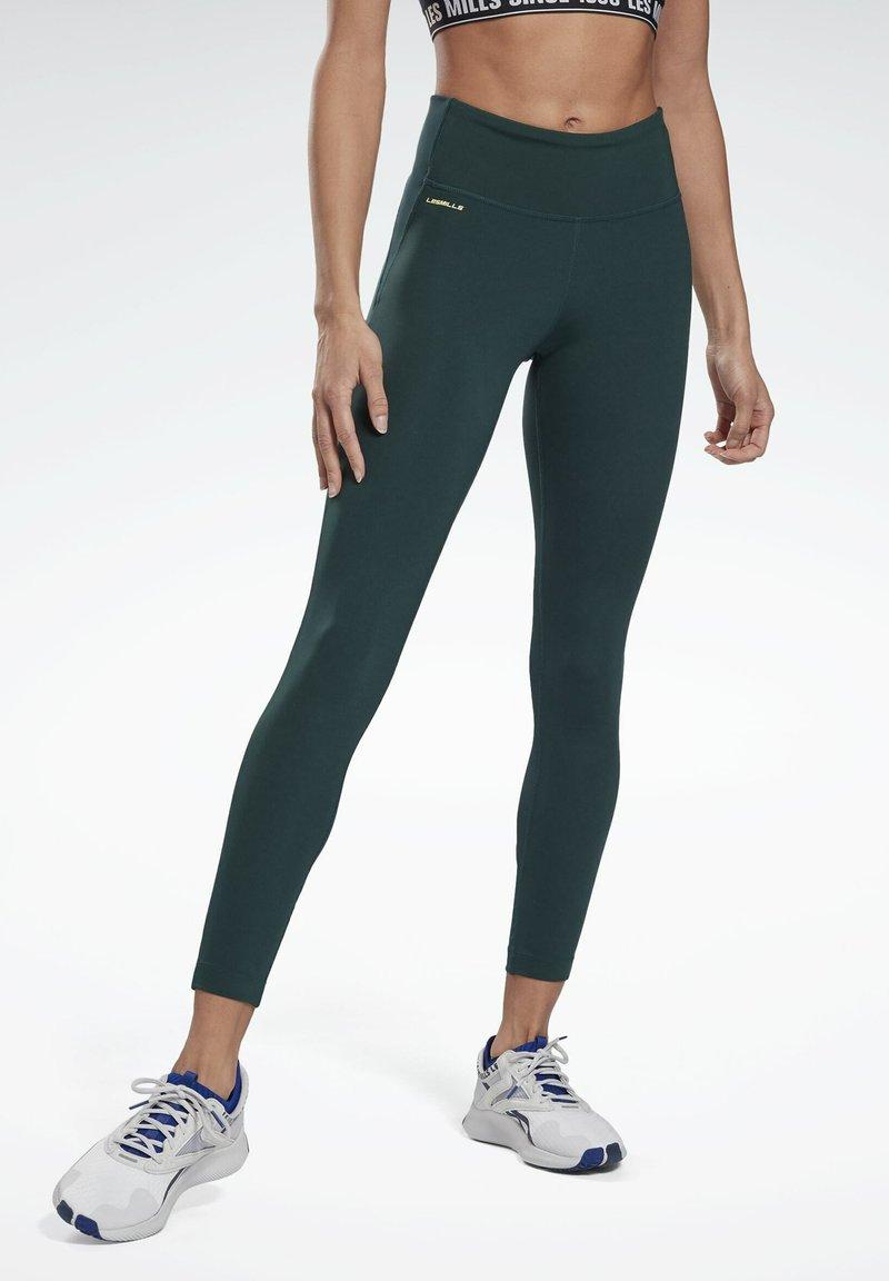 Reebok - LES MILLS® LUX PERFORM LEGGINGS - Leggings - green